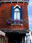 window with potted flowers in Venice