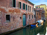 canal with boat in Venice